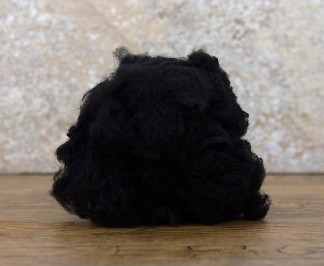 Image of   Bamsefyld / Fyldevat / Fyld til puder / Dukkefyld polyesterfyld sort 200 g