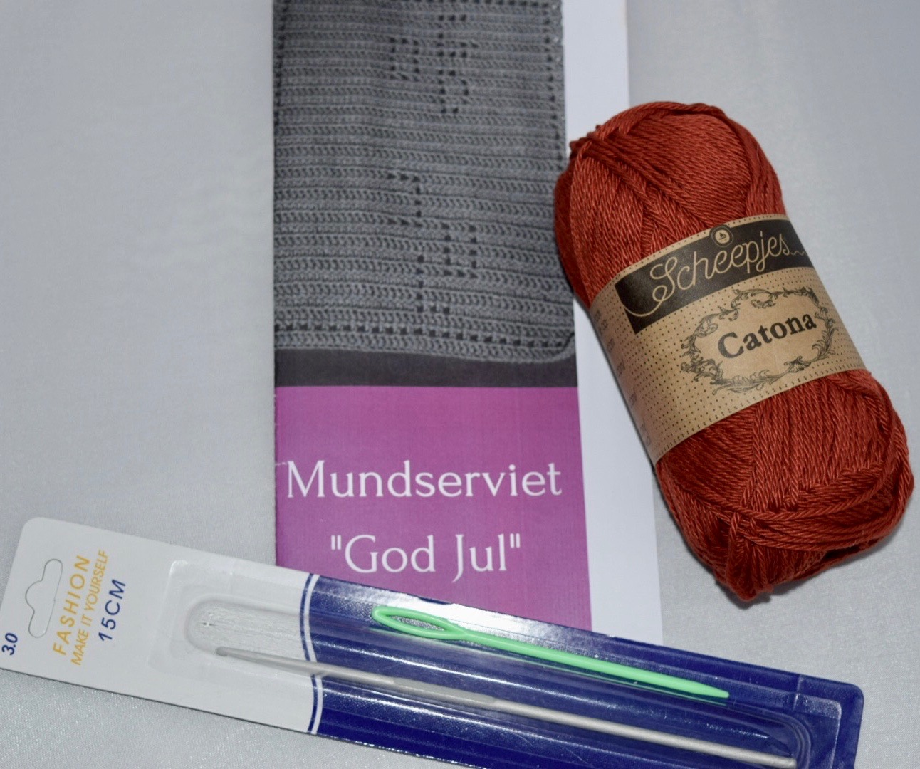 "Image of   Hæklekit Mundserviet ""God Jul"""